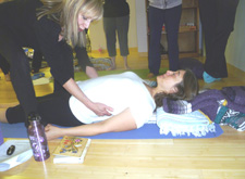 Training yoga teachers in Cobbler's Pose (Baddha Konasana)
